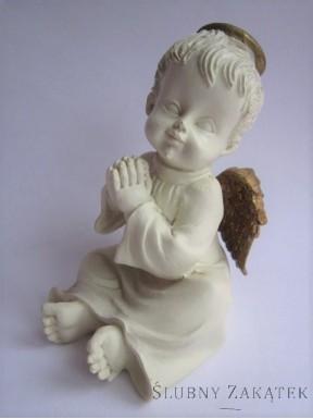 Aniołek kremowy siedzący