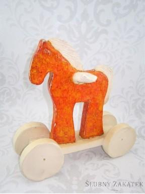 FIGURKA Pegaz na kółkach, pomarańczowy